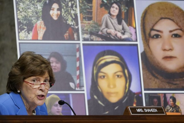 Sen. Jeanne Shaheen, D-N.H., talks about women in Afghanistan, including the seven pictured who were killed there, as she questions the special envoy during a Senate committee hearing on April 27. File Pool Photo by Susan Walsh/UPI