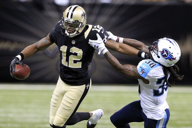 With under 2 minutes left in regulation New Orleans Saints wide receiver Marques Colston (12) takes a Drew Brees pass 13 yards as Tennessee Titans B.W. Webb defends during the fourth quarter at the Mercedes-Benz Superdome in New Orleans November 8, 2015. Photo by AJ Sisco/UPI