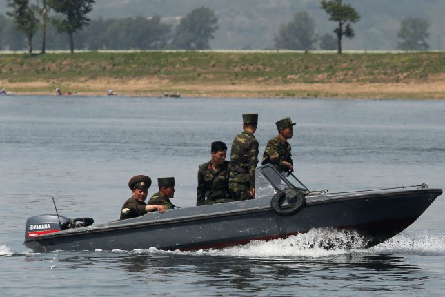 North Korean soldiers patrol the banks of the Yalu River near Sinuiju, across the Yalu River from Dandong, China's largest border city with North Korea. North Korea fired projectiles from the North Korean city of Hamhung on Monday. Photo by Stephen Shaver/UPI