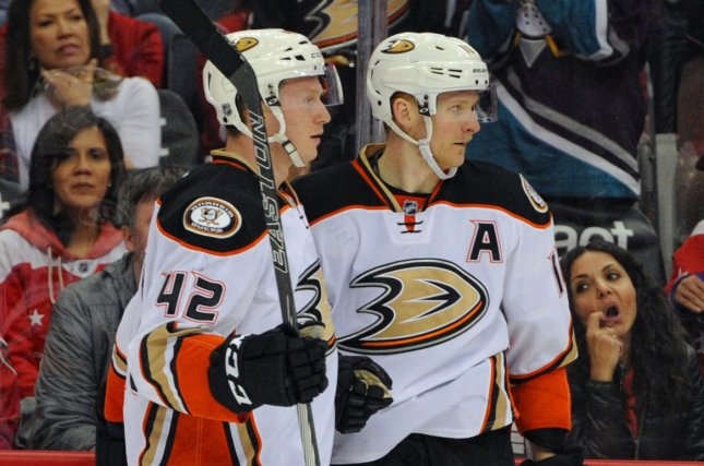 Anaheim Ducks right wing Corey Perry (10) is congratulated by defenseman Josh Manson (42) after scoring. File photo by Mark Goldman/UPI