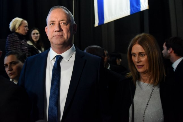 Benny Gantz, leader of the Israeli Blue and White Party, leaves a rally with supporters on March 3 during Israel's third national election in 10 months. Photo by Debbie Hill/UPI
