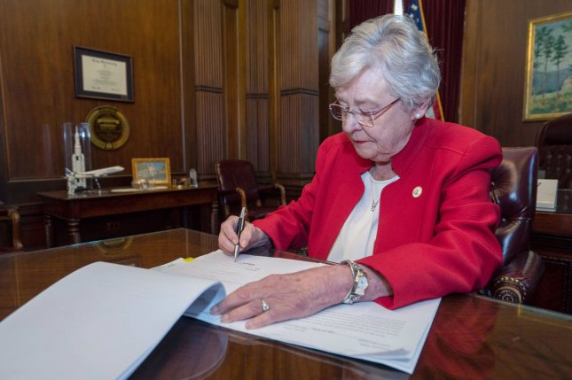 Alabama Governor Kay Ivey, shown here signing the Human Life Protection Act in May 2019, confirmed Friday that she has signed a bill prohibiting transgender youth from playing on sports teams that match their gender identity. UPI file photo
