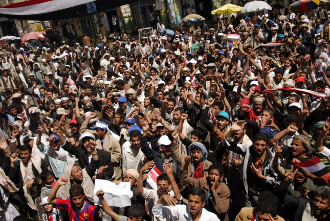 Yemeni protesters chant slogans calling for ouster of President Ali Abdullah Saleh during a massive anti-regime rally in the capital Sanaa, Yemen on March 3, 2011 as Yemen's opposition and clerics offered Saleh a smooth exit from power by the end of this year. UPI/Mohammad Abdullah