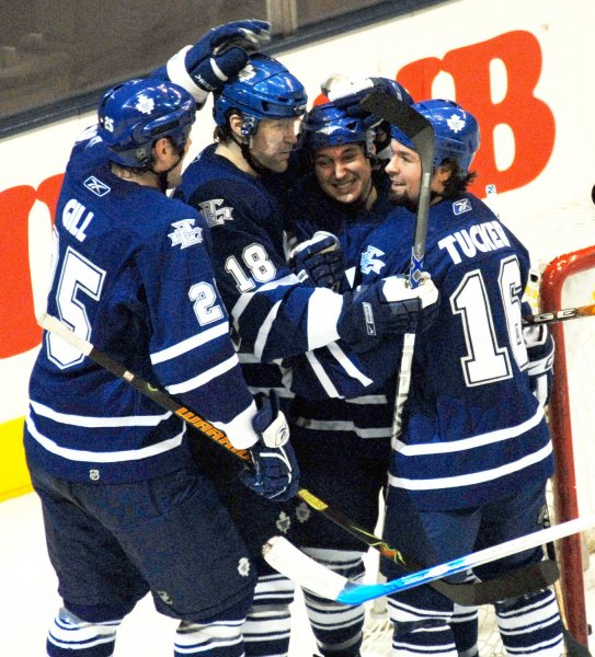 Toronto Maple Leafs (left-to-right) Hal Gill, Chad Kilger, Kyle Wellwood and Darcy Tucker celebrate after Kilger scores the Leafs' first goal against the Tampa Bay Lightning during first period action at the Air Canada Center in Toronto, Canada on March 13, 2007. The Leafs defeated the Lightning 3-2. (UPI Photo/Christine Chew)