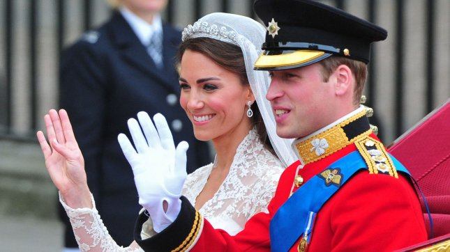 Prince William and Princess Catherine wave as they leave Westminster Abbey in a carriage following their wedding ceremony in London on April 29, 2011. The former Kate Middleton married Prince William in front of 1,900 guests. UPI/Kevin Dietsch