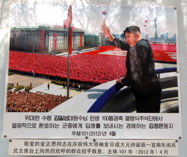 A photo of North Korea's leader Kim Jong Un is displayed on a picture board in front of the North Korean embassy in Beijing on March 22, 2013. UPI/Stephen Shaver