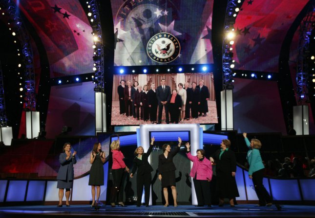 Democratic women of the U.S. Senate acknowledge a photograph of themselves with presumptive Democratic presidential candidate Sen. Barack Obama (D-IL) projected on the stage at the Democratic National Convention at the Pepsi Center in Denver, Colorado on August 26, 2008. From left are Sen. Blanche Lincoln (D-AR), Sen. Maria Cantwell (D-WA), Sen. Mary Landrieu (D-LA), Sen. Barbara Boxer (D-CA), Sen. Amy Klobuchar (D-MN), Sen. Barbara Mikulski (D-MD), Sen. Debbie Stabenow (D-MI), and Sen. Clair McCaskill (D-MO). (UPI Photo/Brian Kersey)