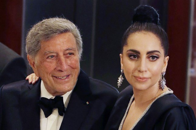 Tony Bennett and Lady Gaga arrive on the red carpet before the taping of an upcoming television concert special 'Cheek To Cheek' at Jazz at Lincoln Center at the Time Warner Center in New York City on July 28, 2014. Lady Gaga and Tony Bennett are collaborating on a jazz record that will be released later this fall. UPI/John Angelillo