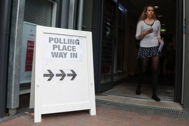 An young lady leaves a polling station on the day Scottish residents decide the future political direction their country will take in Glasgow,Scotland on September 18, 2014. Ninety-seven percent of the population has registered to vote. The verdict will be announced tomorrow morning. UPI/Hugo Philpott