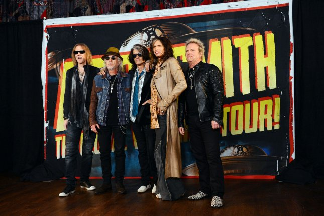 Musicians Tom Hamilton, Brad Whitford, Joe Perry, Steven Tyler and Joey Kramer (L-R) of Aerosmith pose at the press junket to announce their new album, Music from Another Dimension, in West Hollywood on September 18, 2012. File Photo by Jim Ruymen/UPI