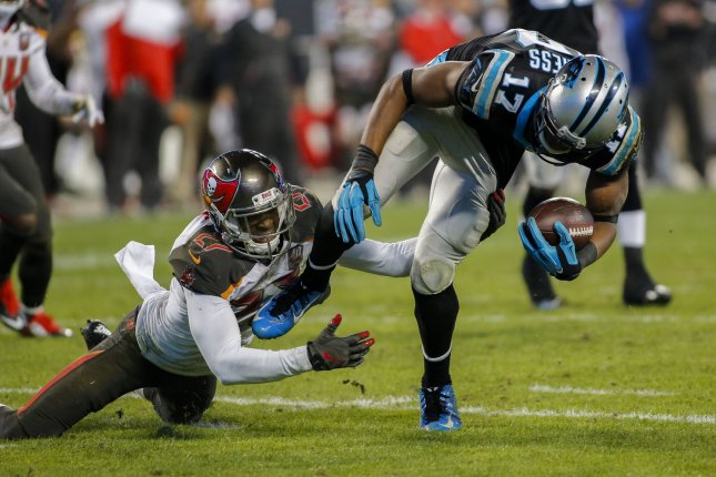 Carolina Panthers wide receiver Devin Funchess, right, breaks free from Tampa Bay Buccaneers cornerback Johnthan Banks to score a touchdown in the second half of an NFL football game at Bank of America Stadium in Charlotte, North Carolina on January 3, 2016. Carolina won 38-10. UPI/Nell Redmond .