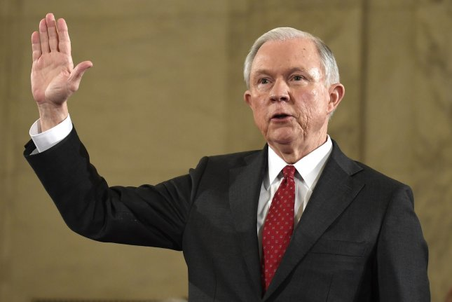 Sen. Jeff Sessions, R-Ala., raises his right hand to be sworn in before testifying before the Senate Judiciary Committee in Washington, D.C., at his nomination hearing to serve as the next U.S. attorney general. Photo by Mike Theiler/UPI