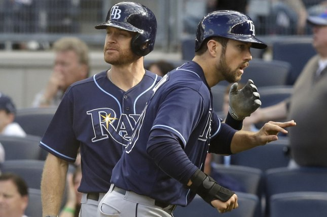 Tampa Bay Rays' Steven Souza celebrates with Logan Forsythe after scoring the game winning run in the 13th inning against the New York Yankees at Yankee Stadium in New York City on April 29, 2015. The Rays defeated the Yankees 3-2 in 13 innings. Photo by John Angelillo/UPI