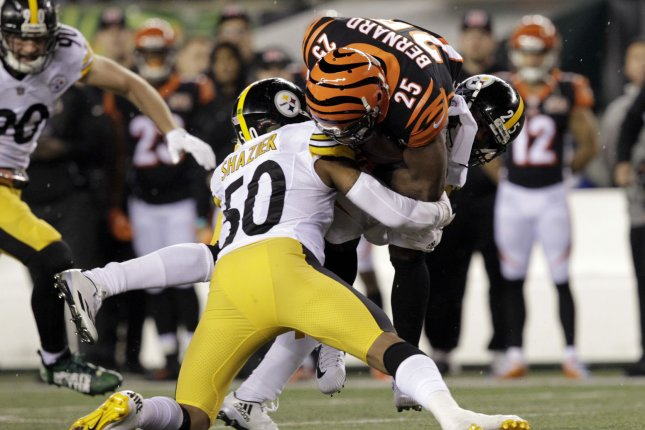 Cincinnati Bengals half back Giovani Bernard (25) is tackled by Pittsburgh Steelers linebacker Ryan Shazier (50) during the first half of play on December 4, 2017 at Paul Brown Stadium in Cincinnati, Ohio. File photo by John Sommers II/UPI