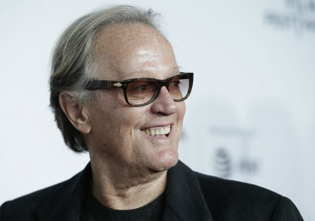Peter Fonda arrives on the red carpet at the 'Clive Davis: The Soundtrack Of Our Lives' Premiere at Radio City Music Hall on April 19, 2017 in New York City. On Wednesday, Fonda apologized for a tweet aimed at President Donald Trump's 12-year-old son. File Photo by John Angelillo/UPI