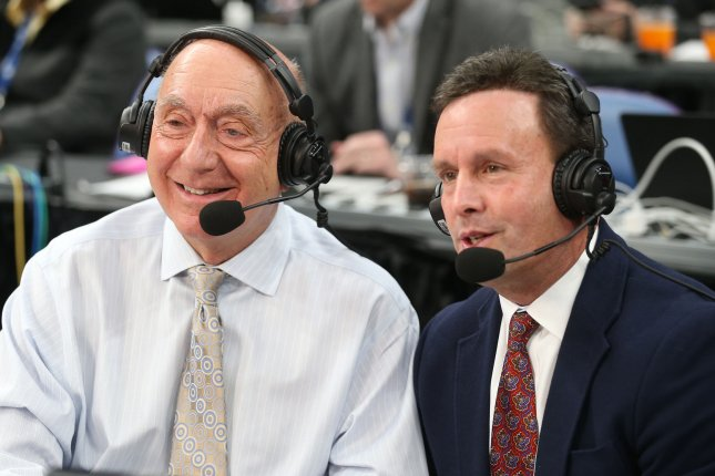 ESPN broadcaster Dick Vitale (L) wants to see more mid-major schools rewarded with bids in the NCAA tournament. Vitale, pictued with fellow broadcaster Karl Ravech, has covered college basketball for 40 years. File Photo by BIll Greenblatt/UPI