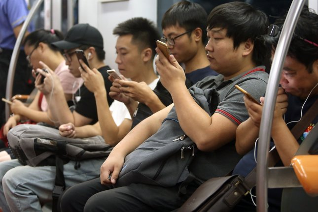 Chinese passengers riding the Beijing subway are facing new restrictions on trains that went into effect on Wednesday. File Photo by Stephen Shaver/UPI