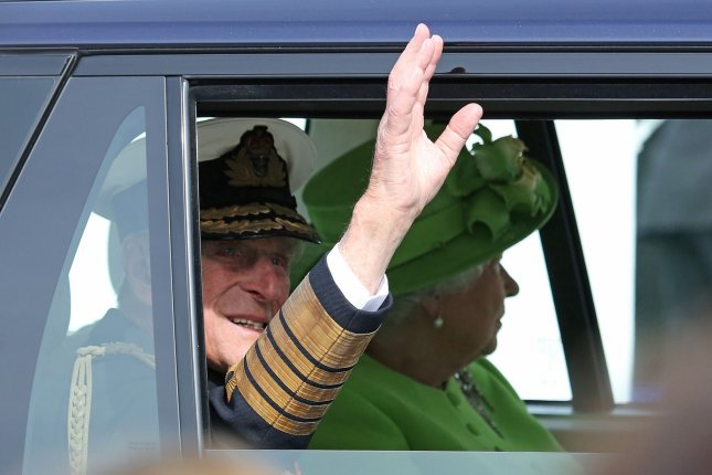 Prince Philip and Queen Elizabeth II leave Sword Beach in Ouistreham, Britain, after a ceremony commemorating the 70th anniversary of the D-Day landings in the Normandy region of France on June 6, 2014. File Photo by David Silpa/UPI