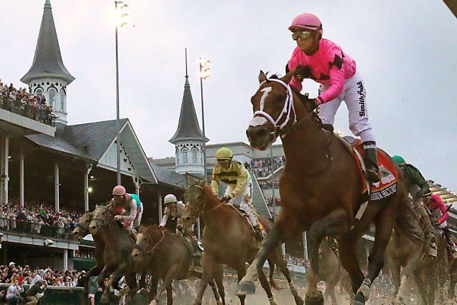 Maximum Security (R) appeared to win the 2019 Kentucky Derby before he was disqualified and the win given to Country House (C) on May 4 at Churchill Downs in Louisville, Ky. File Photo by Mark Abraham/UPI