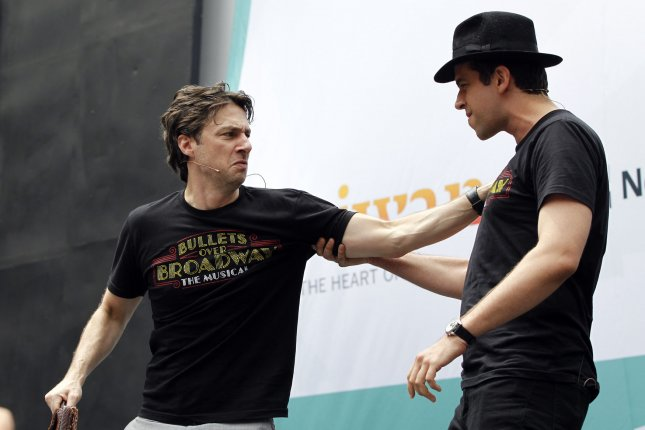 Actors Zach Braff (L) and Nick Cordero perform a song from the Broadway show Bullets Over Broadway at 106.7 LITE FM's Broadway in Bryant Park in New York City on July 24, 2014. File Photo by John Angelillo/UPI