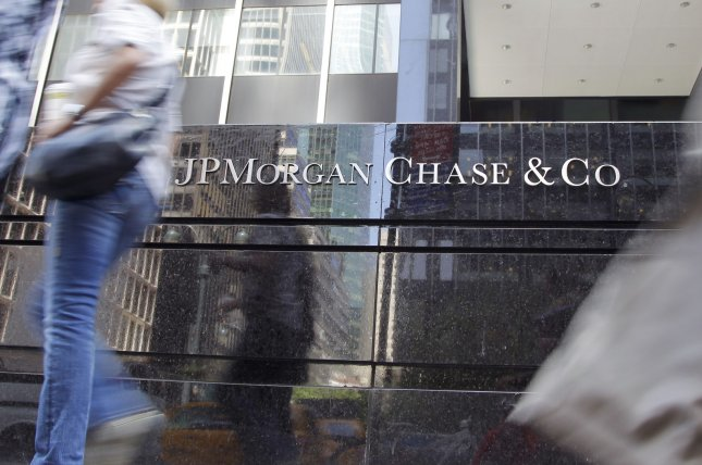 Image of JPMorgan Chase sign hangs at their headquarters on Park Avenue in New York City on May 17, 2012. The bank will pay a $250 million penalty to the U.S. Treasury for lax regulatory rules, the department said Tuesday. Photo by John Angelillo/UPI