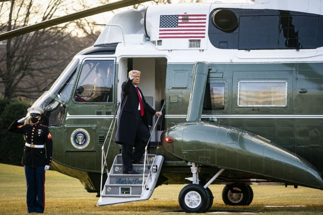President Donald Trump boards Marine One on the South Lawn of the White House in Washington, D.C., on Wednesday as he prepares to leave for the final time as commander in chief. Photo by Al Drago/UPI