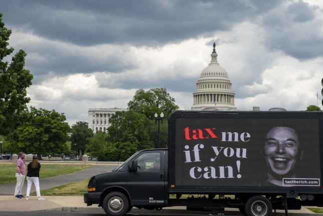 A tax me if you can billboard is seen Monday with Elon Musk's photo near the U.S. Capitol in Washington, D.C. Photo by Tasos Katopodis/UPI