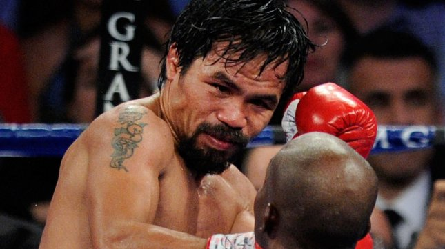 Manny Pacquiao (L) and Timothy Bradley battle it out during their title fight at the MGM Grand Garden Arena on June 9, 2012 in Las Vegas, Nevada. Bradley won the WBO welterweight fight in a split decision in the 12-round bout. UPI/David Becker