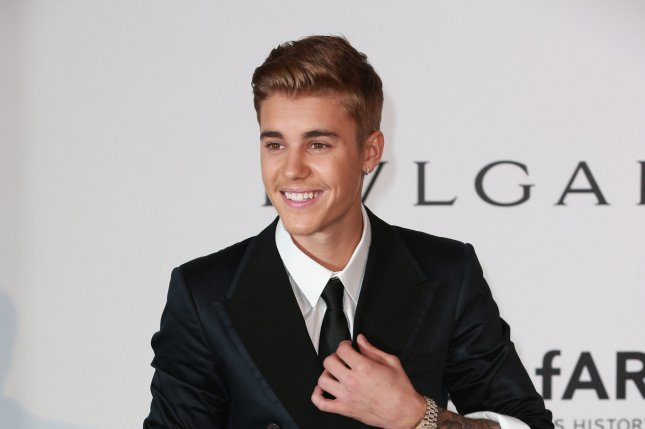 Justin Bieber arrives at the 21st amfAR Cinema Against AIDS 2014 gala at the Hotel du Cap in Antibes, France on May 22, 2014. The event, held each year during the annual Cannes Film Festival, raises funds for AIDS research. UPI/David Silpa