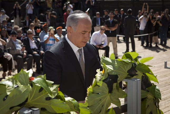 Israeli Prime Minister Benjamin Netanyahu lays a wreath during a ceremony marking the annual Holocaust Remembrance Day at the Yad Vashem Holocaust memorial, in Jerusalem, Thursday. Israelis stop in their tracks and stand in silence as sirens pierce the air to remember the six million Jews who perished in the Nazi Holocaust during World War II. Pool Photo by Dan Balilty/UPI