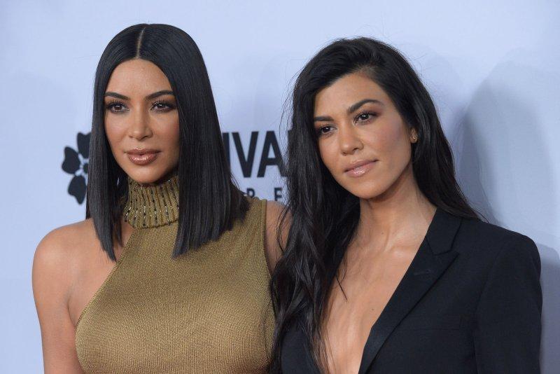Kourtney Kardashian (R) and sister Kim Kardashian attend the Los Angeles premiere of The Promise on Wednesday. Photo by Jim Ruymen/UPI