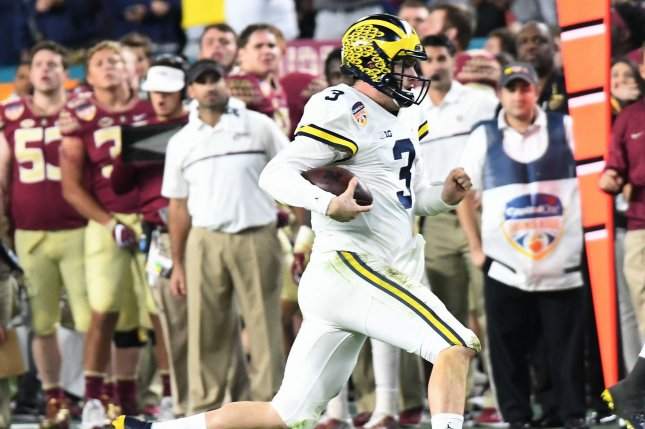 Michigan Wolverines QB Wilton Speight runs against the Florida State Seminoles in the fourth quarter of the 2016 Capital One Orange Bowl at Hard Rock Stadium in Miami Gardens, Florida on December 30, 2016. File photo by Gary Rothstein/UPI