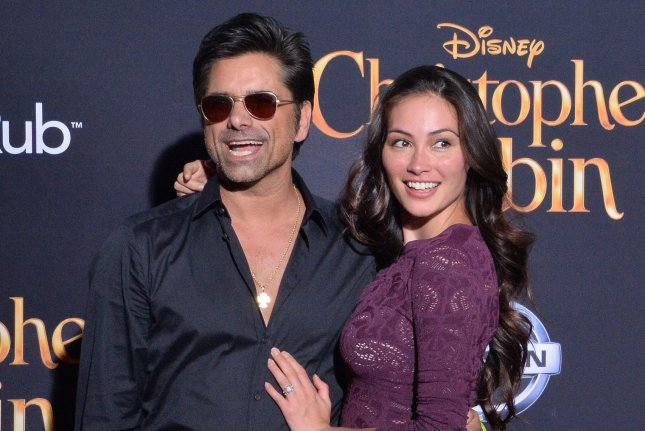 John Stamos (L) and Caitlin McHugh attend the premiere of Christopher Robin in Burbank, Calif., on Monday. Photo by Jim Ruymen/UPI