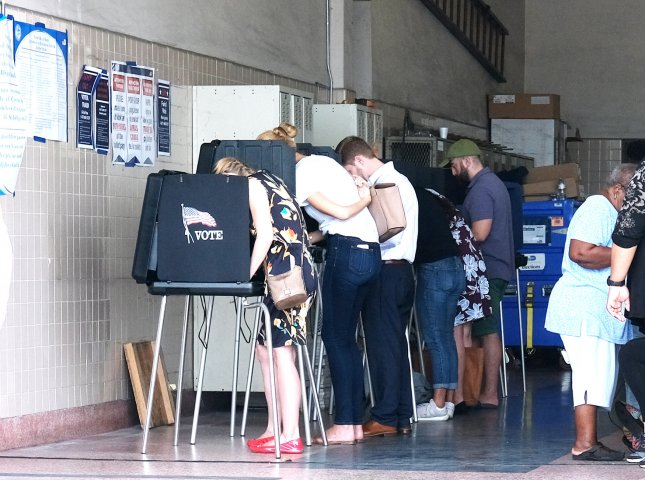 Florida residents cast their ballot on Election Day at a Miami fire station. Photo by Gary I Rothstein/UPI