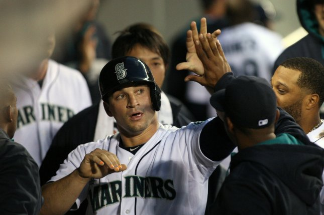 Seattle Mariners catcher Mike Zunion is high fived in the dugout after scoring a run against the New York Yankees. File photo by Jim Bryant/UPI