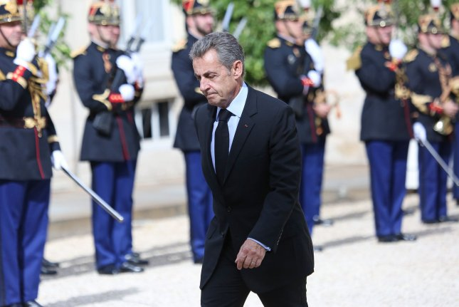 Former French President Nicolas Sarkozy is pictured walking at Elysee Palace in Paris, France, on September 30, 2019. File Photo by David Silpa/UPI