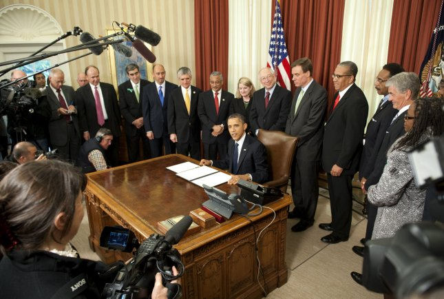 President Barack Obama speaks after signing a proclamation to designate Ft. Monroe, in Hampton, Virginia, a National Monument, in the Oval Office of the White House in Washington on November 1, 2011. Obama was joined by, from left to right, Mark Perreault, President, Citizens for Fort Monroe National Park, Glen Odor, Executive Director, Fort Monroe Authority, Adam Goodheart, Civil War Historian, Washington College, Rep. Scott Rigell (R-VA), Rep. Bobby Scott (D-VA), Mayor Molly Ward, Hampton, VA, Secretary Ken Salazar. Sen. Mark Warner (D-VA), Lacy Ward, Jr., Director, Robert Russa Moton Museum, Farmville, VA, Rep. Emanuel Cleaver (D-MO), Secretary of the Army John McHugh, State Senator Mamie Locke, VA, Rev. Anderson W. Clary, Jr., Queen Baptist Church, Director of the National Park Service Jon Jarvis and CEQ Chair Nancy Sutley. UPI/Kevin Dietsch