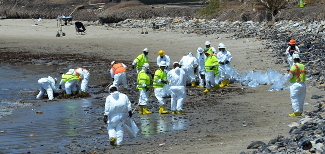 Workers continue the cleanup along Refugio Beach as efforts continue to remove the oil that has spilled an estimated 100,000 gallons off the Santa Barbara County coast. A unified command center established for the spill said the worst-case estimate is that 2,500 barrels of oil was released from a pipeline operated by Plains All American. Photo by Jim Ruymen/UPI