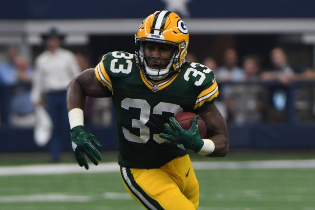 Green Bay Packers RB Aaron Jones rushes against the Dallas Cowboys during the first half Sunday at AT&T Stadium in Arlington, Texas. Photo by Ian Halperin/UPI