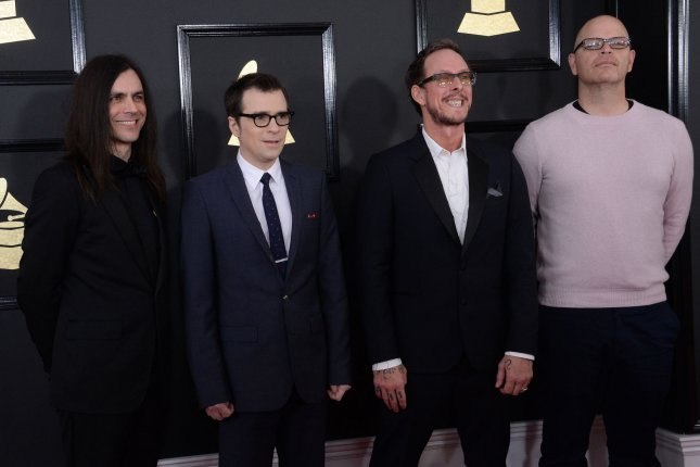 Left to right, Brian Bell, Rivers Cuomo, Scott Shriner, and Patrick Wilson of Weezer. The band joined Jimmy Fallon for a cover of Take on Me using classroom instruments. File Photo by Jim Ruymen/UPI