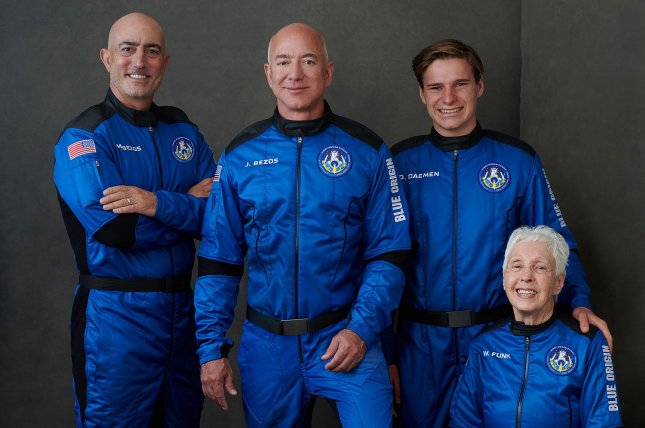 Blue Origin's New Shepard suborbital rocket went to space on Tuesday, with people aboard for the first time, including founder Jeff Bezos (2L). He was joined by his brother, Mark Bezos (L), 82-year-old aviator Wally Funk (R) and 18-year-old Oliver Daemen of the Netherlands. Photo by Blue Origin