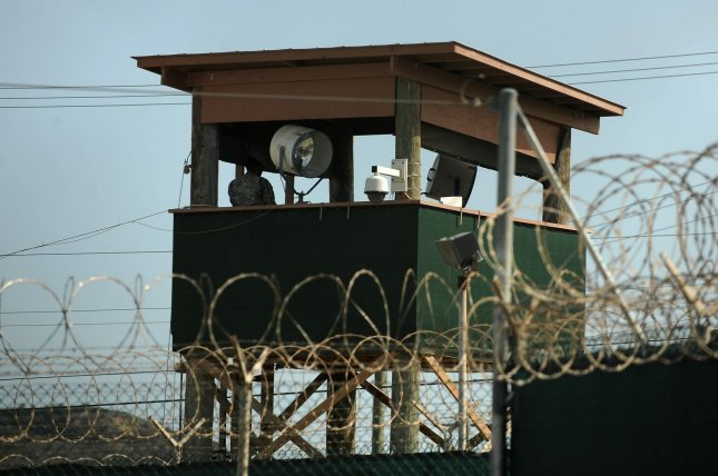 A guard watches over detainees in Camp IV in Camp Delta at Naval Station Guantanamo Bay in Cuba on July 8, 2010. UPI/Roger L. Wollenberg