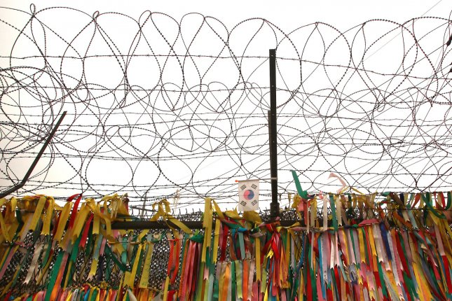Ribbons made by students hoping for a peaceful reunion between North and South Korea hang under barbed wire near the Demilitarized Zone (DMZ) and the Freedom Bridge, close to Seoul on January 29, 2013. On Sunday, 30 women activists will cross the DMZ from North Korea and travel to South Korea. UPI/Stephen Shaver