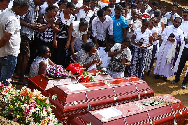 Relatives of victims weep during the funeral of their family members killed in the Easter Sunday bombings in Colombo, Sri Lanka on Tuesday. Photo by Perera Sameera/UPI