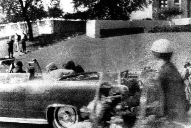 President John F. Kennedy slumps into the arms of his wife, Jackie, immediately after he was shot as his motorcade made its way through Dealey Plaza in Dallas, Texas on November 22, 1963. UPI File Photo