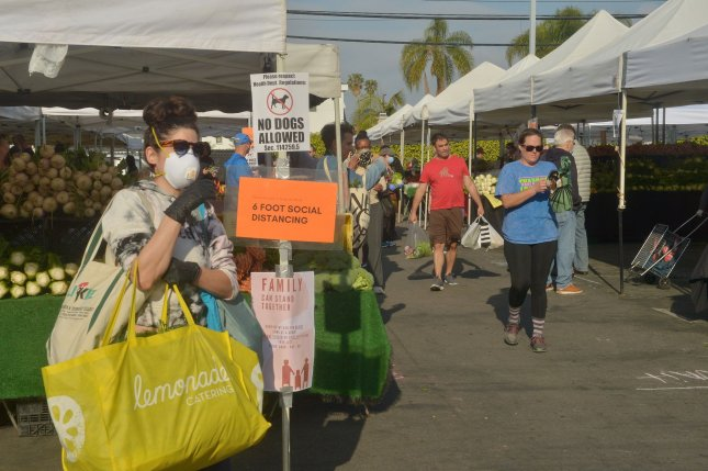 Shoppers browse food and other items at a farmer's market in Los Angeles, Calif., on Sunday. International leaders say nations of the world reacting to the coronavirus outbreak must ensure that their emergency actions don't inadvertently disrupt the food supply chain. Photo by Jim Ruymen/UPI