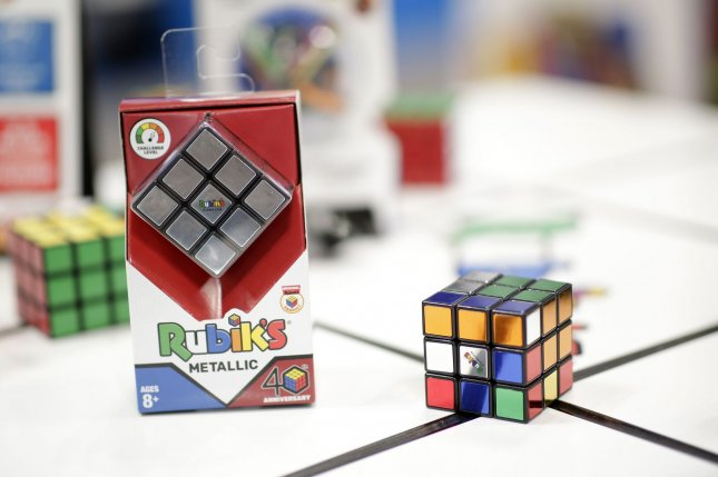 A Colorado 14-year-old captured a Guinness World Record when he solved a Rubik's cube in 16.710 seconds while bouncing on a pogo stick. File Photo by John Angelillo/UPI
