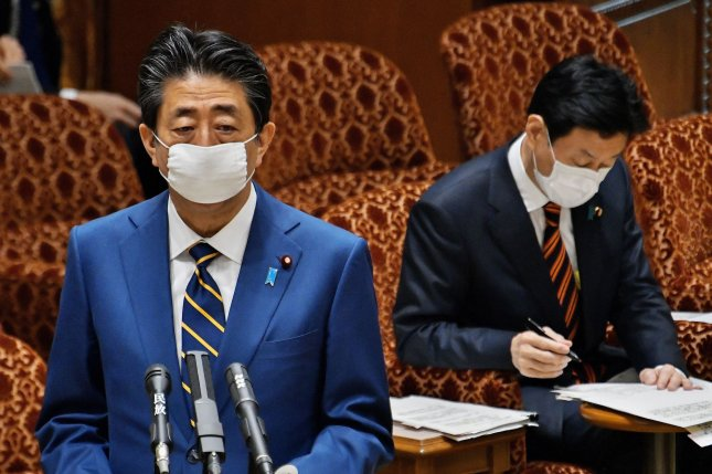 Japan's Prime Minister Shinzo Abe (L) is cooperating with an investigation into dinners held for his supporters while in office. File Photo by Keizo Mori/UPI