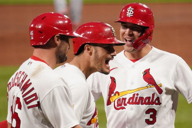 St. Louis Cardinals third baseman Nolan Arenado (C) celebrates his three-run home run with Dylan Carlson (R) and Paul Goldschmidt (L) in the third inning of a win over the New York Mets on Monday at Busch Stadium in St. Louis. Photo by Bill Greenblatt/UPI