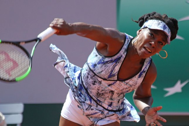 American Venus Williams hits a serve during her French Open women's second round match against Kurumi Nara of Japan at Roland Garros in Paris on May 30, 2017. Williams was ousted from the tournament on Sunday, losing to 30th-seeded Timea Bacsinszky of Switzerland 5-7, 6-2, 6-1. Photo by David Silpa/UPI